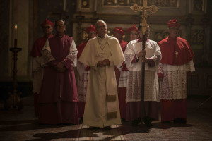 REENACTMENT- Bergoglio goes through the doors of the vatican. (Actors from left to right: Extras, Kepa Amuchastegui and René Figueroa)              (Photo Credit: National Geographic Channels/ Santiago García)