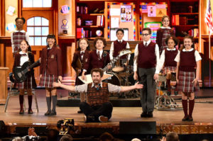 NEW YORK, NY - JUNE 12:  Alex Brightman (C) and the cast of  'School of Rock' perform onstage during the 70th Annual Tony Awards at The Beacon Theatre on June 12, 2016 in New York City.  (Photo by Theo Wargo/Getty Images for Tony Awards Productions)